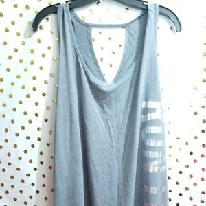 Gray tank top that says run this down the side
